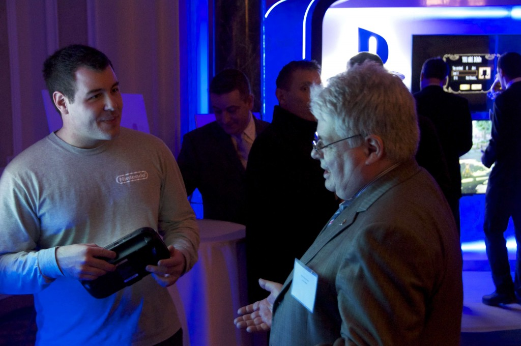 Louis Plamondon, interim leader of the Bloc Quebecois, and MP for Bas-Richelieu-Nicolet-Bécancour, Que. talking to a spokesperson from Nintendo Canada.