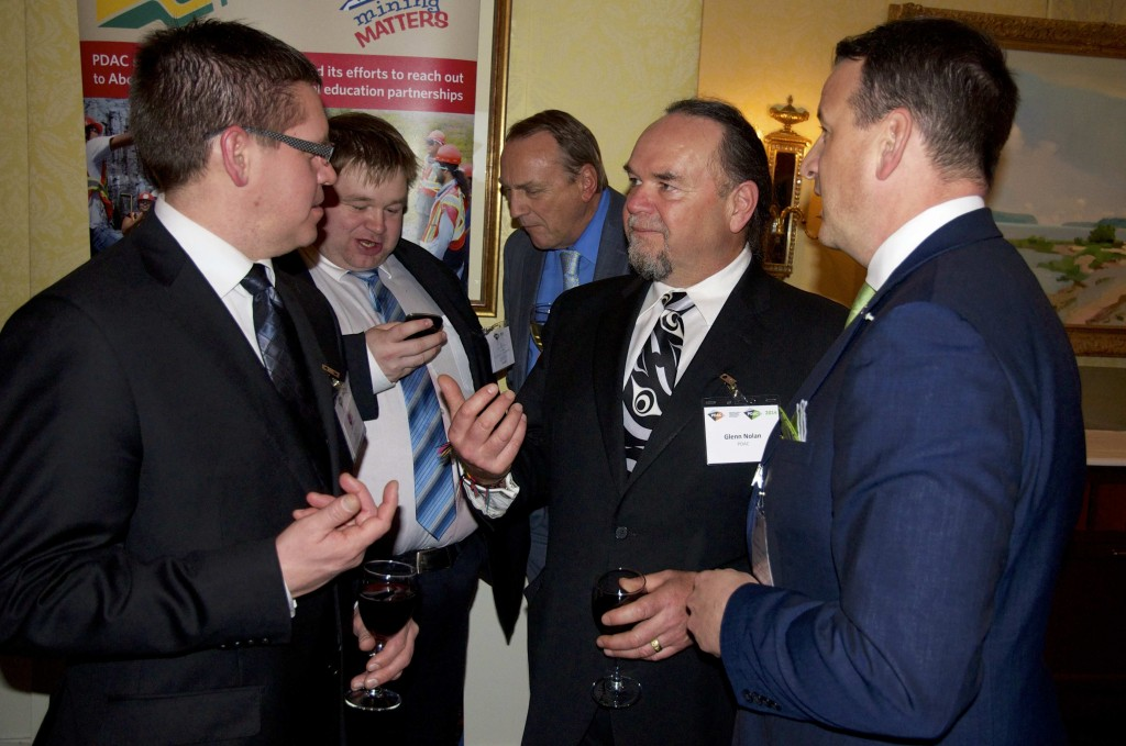 Glenn Nolan, acting PDAC President (middle) has a chance to converse with Greg Rickford, MP of Kenora (right)