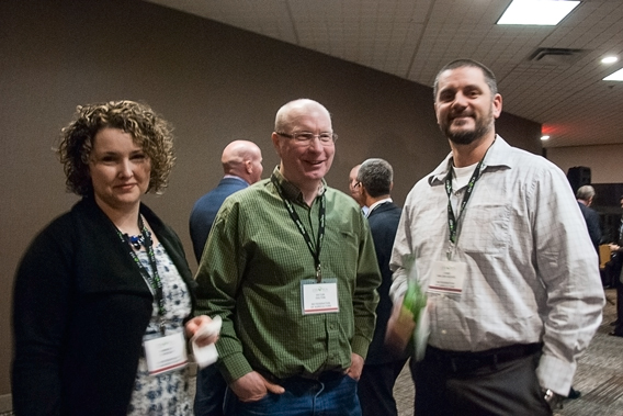From left to right: Nova Scotia Federation of Agriculture Vice-President Kimberly Stokdjik, Director Victor Oulton and President Chris Van Den Heuvel wait for remarks from Agriculture Minister Gerry Ritz at the CFA reception.