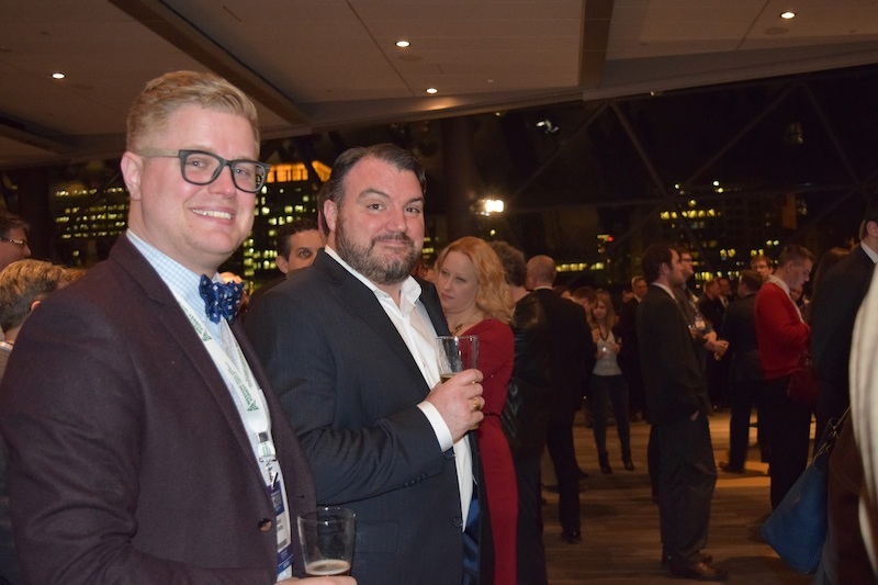 Former Conservative staffer Jamie Ellerton (left) with Greg MacEachern, VP of government relations at Environics Communications (right)