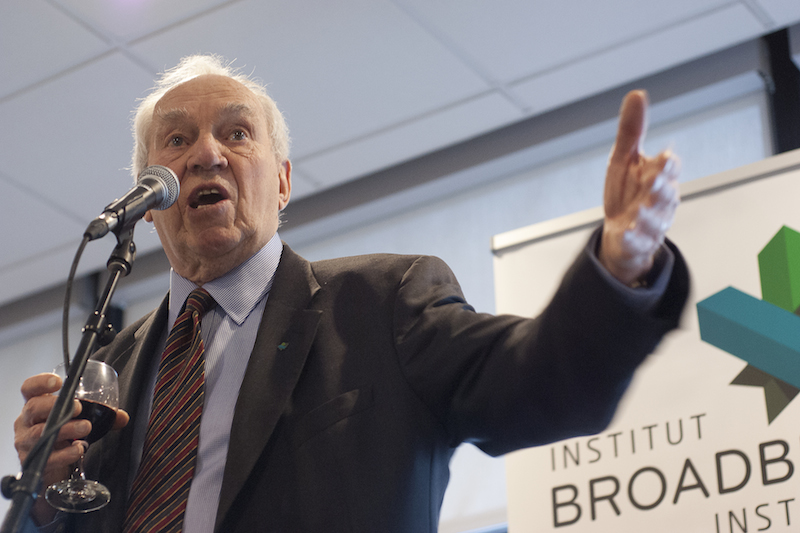 Ed Broadbent, former leader of the federal NDP between 1975 and 1989, welcomes delegates to the Progress Summit March 26. He said he told his colleauges he wouldn't be speaking long, so was fine holding on to his own glass of wine. Alyssa O'Dell photo.